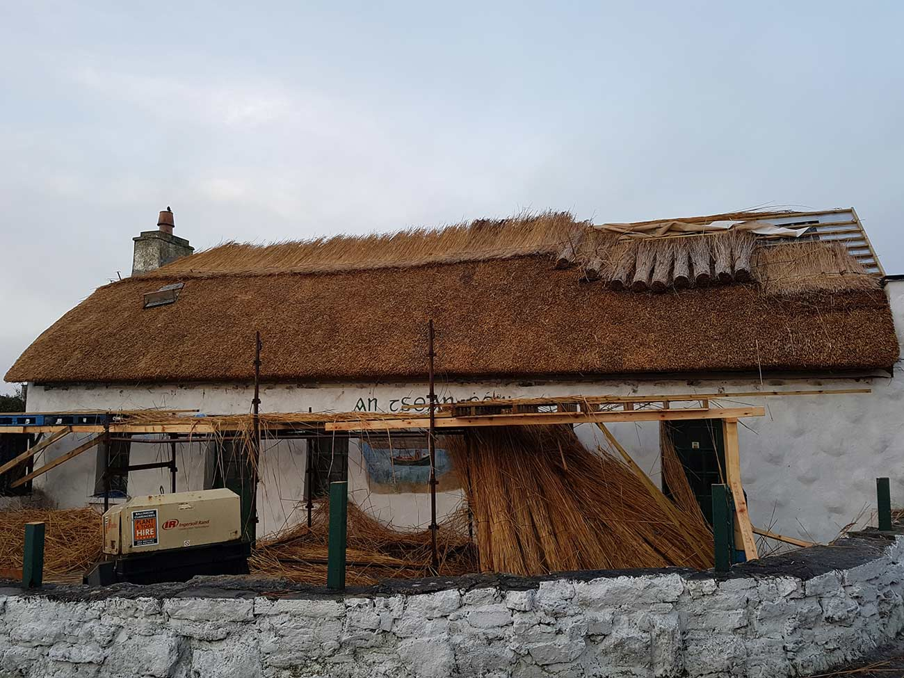sean ceib roof thatching in progress