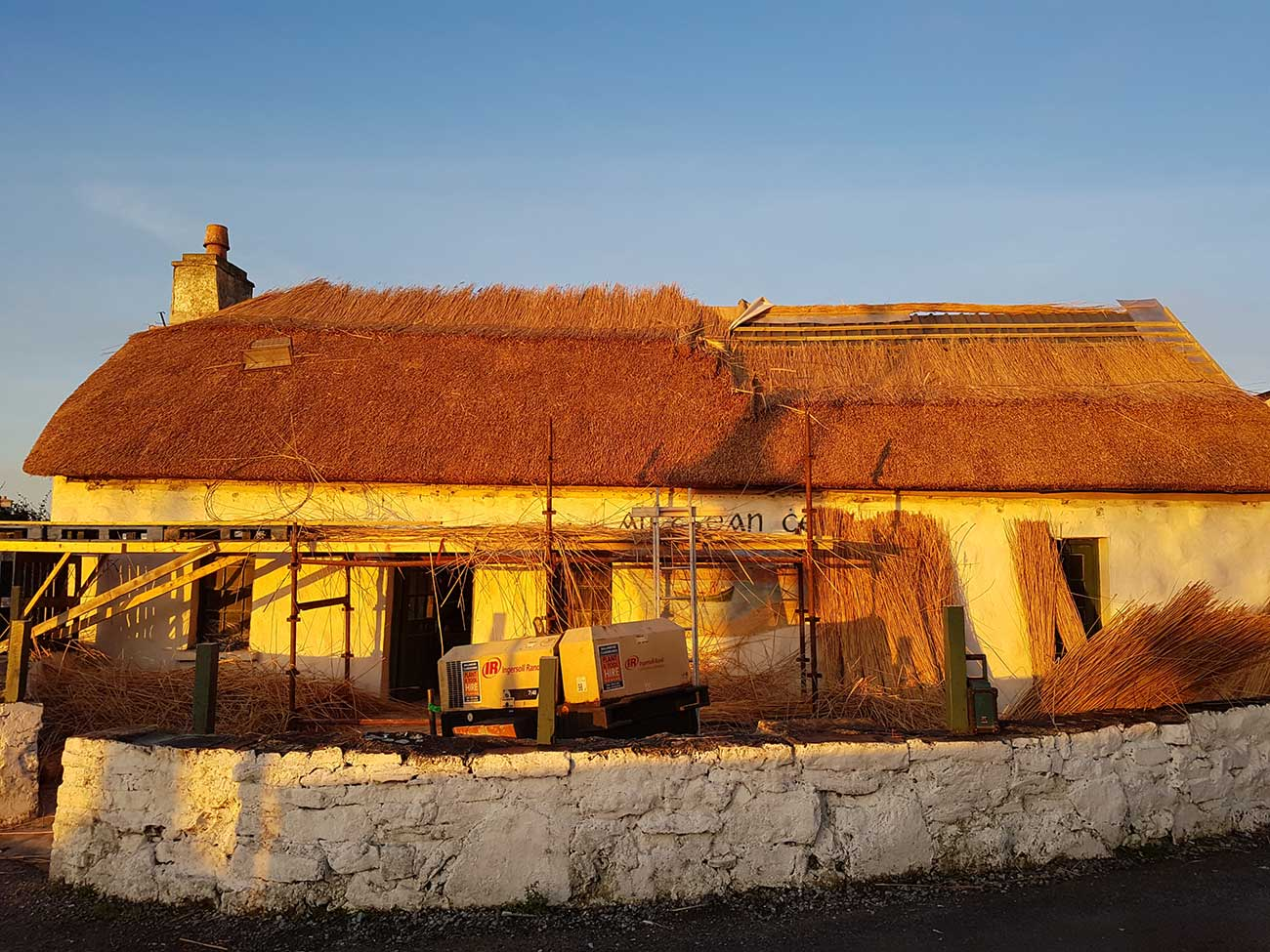 thatched roof during sun set tsean ceib