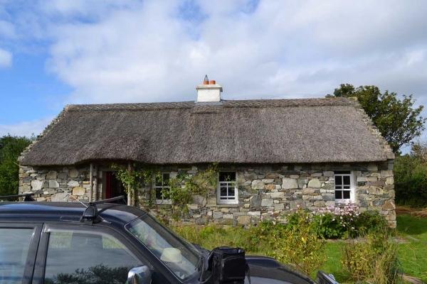 old thatch on rural irish cottage