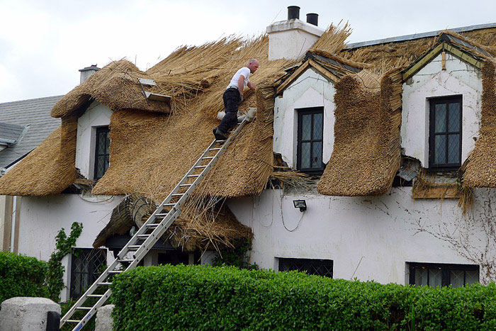 tullycross during thatching process