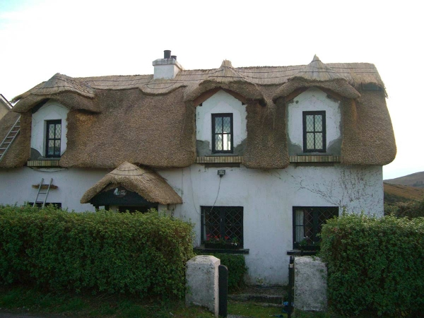 tullycross two story ronan finn thatched home